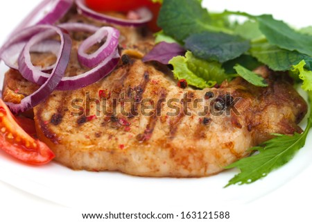 Grilled meat steak with herbs and tomatoes, onions, peppers, isolated on white background - stock photo