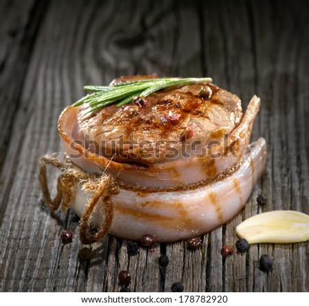 grilled meat with bacon on wood - stock photo