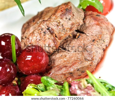grilled meat with grapes