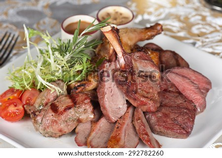 grilled meat with herbs and vegetables - stock photo