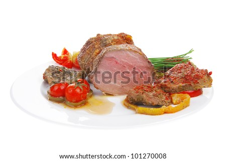 grilled meat with slices served on plate - stock photo