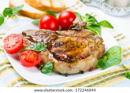Grilled meat with tomato and corn salad