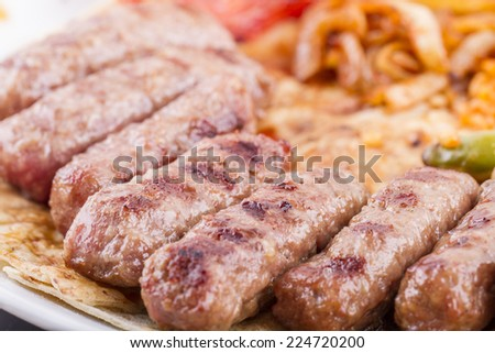 Grilled meatballs on a white plate - stock photo