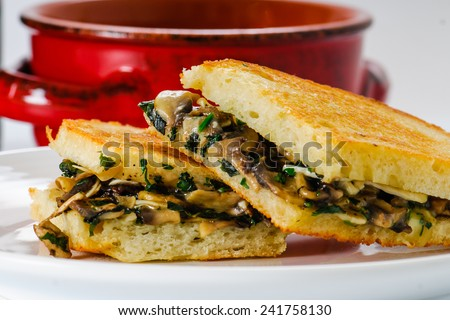 Grilled mushroom and Brie Cheese sandwich with bowl of soup - stock photo