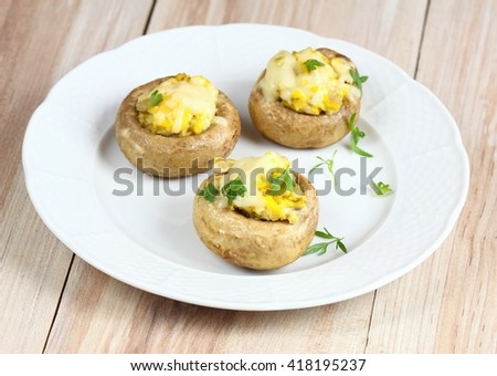 Grilled mushroom filled with eggs and cheese