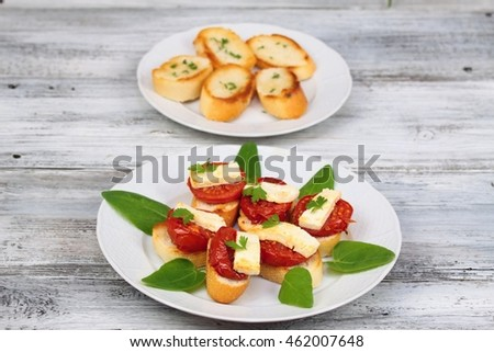 Grilled open sandwich with  tomato and  cheese decorated with spinach leaves, parsley
