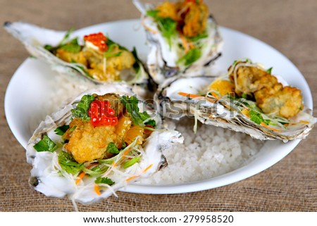 Grilled oyster with flour and salmon egg - stock photo