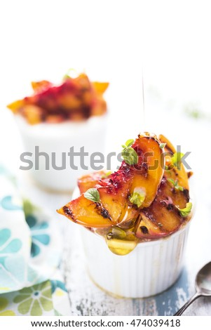 Grilled peaches dessert with honey and thyme