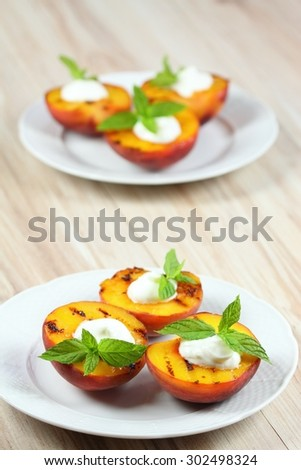 Grilled peaches, mascarpone  and mint - stock photo