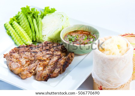 grilled pork and sticky rice on white plate