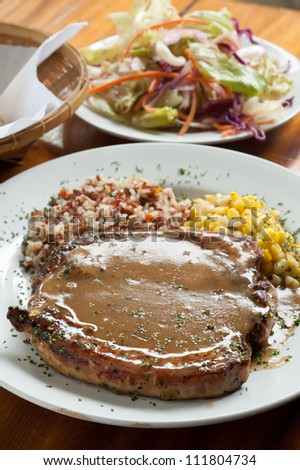 Grilled Pork chop Steaks with corn and rice - stock photo