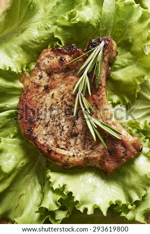 grilled pork chop with green salad - stock photo