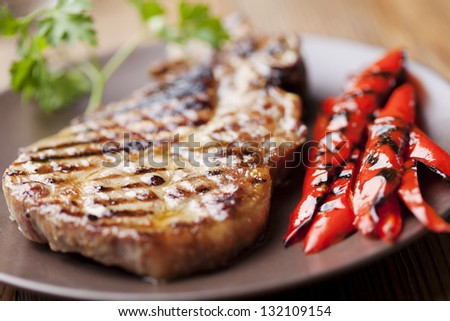 grilled pork chop with grilled red pepper - stock photo
