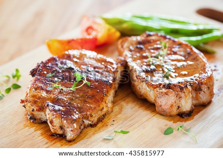 grilled pork chop with thyme and vegetable