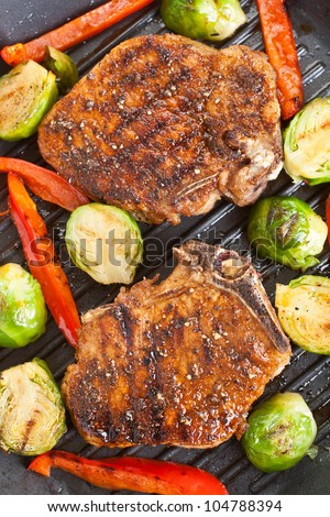 grilled pork chops with vegetables - stock photo