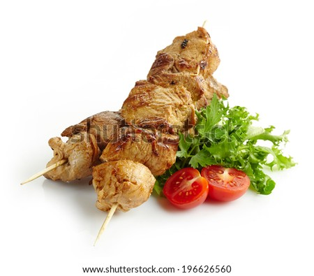 grilled pork meat kebab on wooden skewers