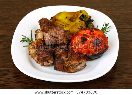 Grilled pork meat - shaslik with tomato and pepper