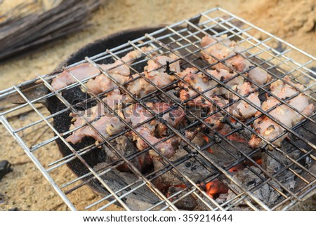 Grilled pork on the grill