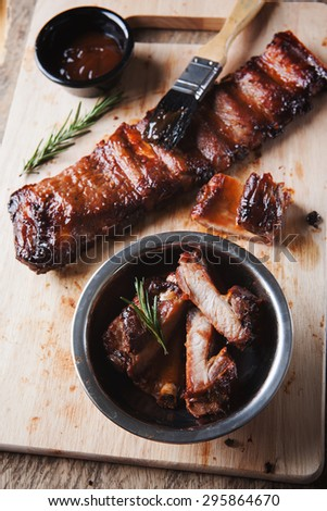grilled pork rib with sauce on wooden board - stock photo
