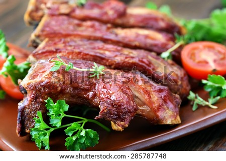 Grilled pork ribs on plate, shallow depth of field - stock photo