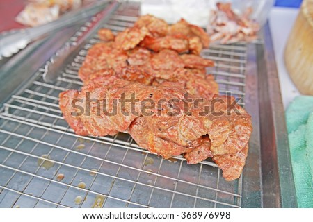 Grilled pork ribs on steel tray - delicious toasted traces - thai style - stock photo