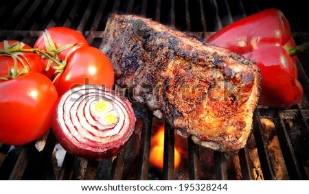 Grilled pork ribs on the BBQ grill. You can see more BBQ food, BBQ Tools, Flaming Grill, Burning&Glowing Coal in my image gallery and public sets.  - stock photo