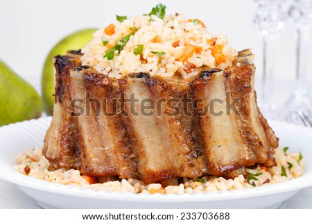 Grilled pork ribs with rice and spices - stock photo