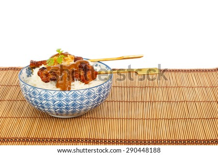 Grilled pork satay with peanut sauce and rice against white background - stock photo