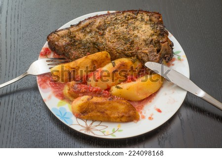 Grilled pork steak and potatoes - stock photo