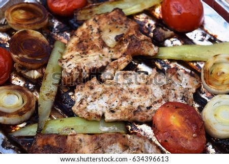 Grilled Pork steak and vegetables . Hot Meat Dishes. Top view