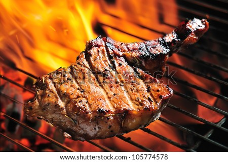 Grilled pork steaks on the grill - stock photo