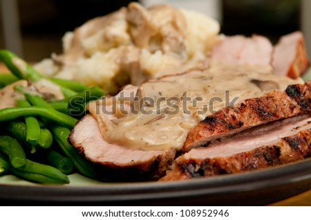 grilled pork tenderloin with a rich mushroom sauce, red skinned mashed potatoes and fresh green string beans