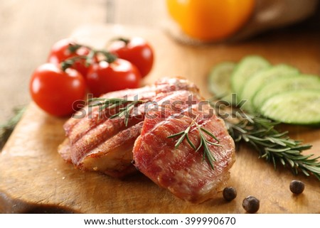 Grilled pork with vegetables on cutting board