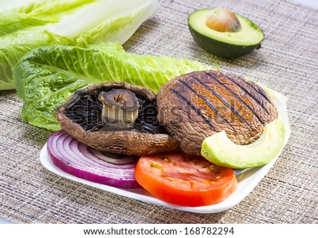 Grilled portabella mushroom served with vegetables . - stock photo