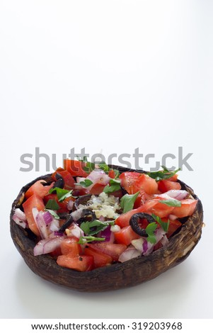 Grilled portobello mushroom topped with chopped vegetables. Isolated on white. - stock photo