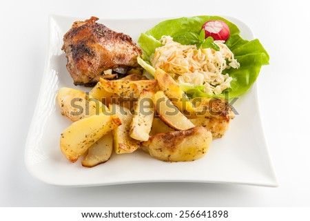 grilled potatoes with herbs, chicken and vegetable salad