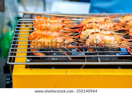 Grilled prawns on the electricity grill in fresh food market - stock photo