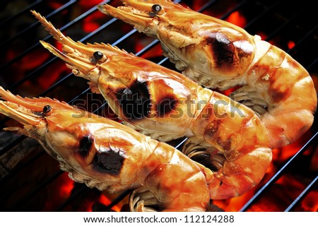 Grilled prawns on the grill - stock photo