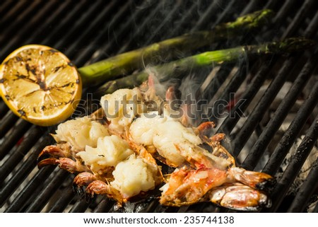 Grilled prawns on the grill. Shallow dof.  - stock photo