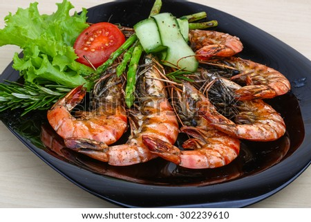 Grilled prawns with asparagus, rosemary and salad leaves - stock photo