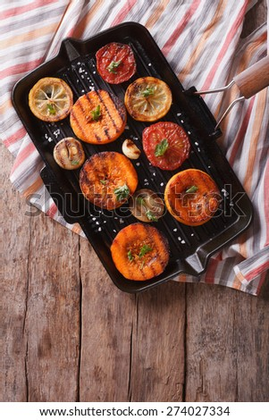 Grilled pumpkin and vegetables on the grill pan. vertical view above, rustic style - stock photo