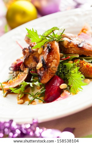 Grilled quail breasts with fig and beet salad for holiday - stock photo