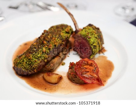 Grilled rack of lamb with mint and pistachio - stock photo