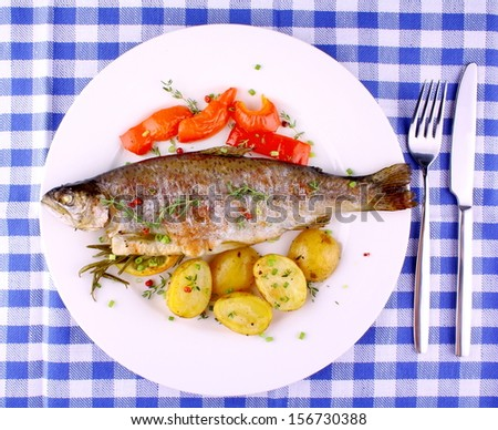 Grilled rainbow trout with red pepper, potato and lemon, top view - stock photo