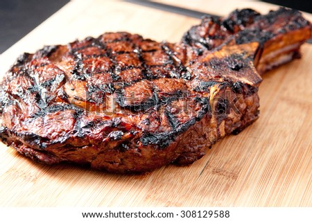 grilled rare rib cut steak with lots of fat
