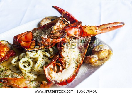 Grilled red Lobster on platter. - stock photo