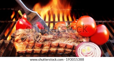 Grilled Ribs, Bell-pepper, tomato on the Flaming Grill. You can see more BBQ food, BBQ Tools, Flaming Grill, Burning&Glowing Coal in my image gallery and public sets.  - stock photo