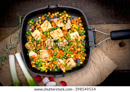 Grilled - roasted chicken meat (chicken breast) and vegetables