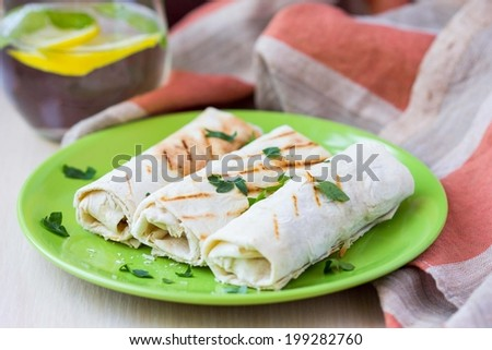 Grilled rolls of bread lavash with cheese suluguni, peppers, picnic lunch, snack, delicious dish - stock photo