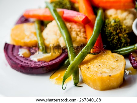 Grilled salad with sauce on a white plate. Restaurant - stock photo